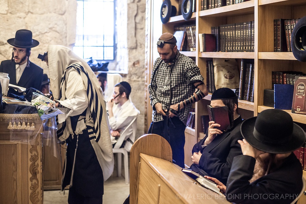 A group of Haredim pray and get ready for prayers at King David's Tomb, on Mount Zion in Jerusalem.