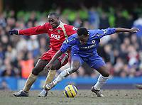 Photo: Lee Earle.<br /> Chelsea v Portsmouth. The Barclays Premiership. 25/02/2006. Chelsea's Michael Essien (R) holds off Lomana Lua Lua.