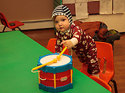 toddler playing with drum