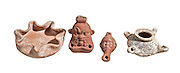 Various Terra-cotta Oil Lamps from left to right 1. Iron Age 10th century BC 2. Egyptian God Hellenistic Faiyum 2nd century BC. 3. Egyptian oil lamp in the form of a head 2nd century BC. 4. Terracotta oil lamp for three flames Hellenistic period 2nd century BC. 8-12 cm high