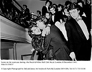 Scene on the staircase during  the Black & White Ball. Cafe Royal. London. 8 December 1981. Film 81350f37<br />