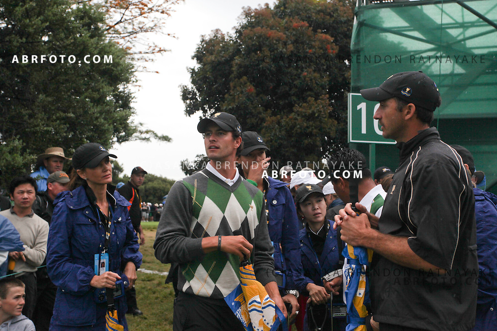 19 November 2011 : International Adam Scott looks at the Jason Days approach shot, his girlfriend Ana Ivanovic is in the background.  during the third-round Foursome matches at the Presidents Cup at the Royal Melbourne Golf Club in Melbourne, Australia. .