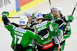 Players of HDD Tilia Olimpija celebrate during ice-hockey match between HDD Tilia Olimpija and SAPA Fehervar AV19 at fourth match in Quarterfinal  of EBEL league, on Februar 26, 2012 at Hala Tivoli, Ljubljana, Slovenia. HDD Tilia Olimpija won 6:4. (Photo By Matic Klansek Velej / Sportida)