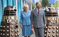 CARDIFF- UK- 03- JULY 2013: Britain's Prince Charles and the Duchess of Cornwall arrive at the BBC's Dr Who studios in Cardiff, Wales. They were greeted by 2 Daleks.<br /> Photo by Ian Jones