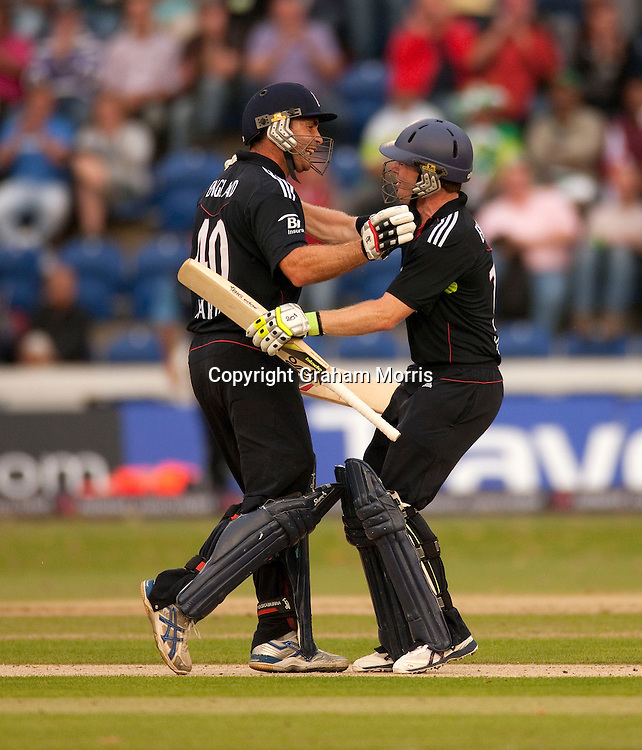 Michael Yardy (left) and Eoin Morgan celebrate winning the first T20 international between England and Pakistan in Cardiff.  Photo: Graham Morris (Tel: +44(0)20 8969 4192 Email: sales@cricketpix.com) 05/09/10