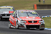 Craig Lowndes(Team Vodafone) leads Rick Kelly. Official Test Day of the 2011 V8 Supercar Championship Series. Eastern Creek International Raceway on Saturday 29 January 2011. Photo © Clay Cross / PHOTOSPORT