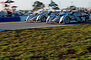 The No. and No. 3 Audis side-by-side during testing at the 2012 12 Hours of Sebring.