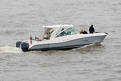 © Licensed to London News Pictures. 13/05/2018. London, UK. Alan Sugar's guests take a short ride on the tender boat from his luxury superyacht, Lady A as it is moored at Butlers Wharf on the River Thames today shortly before Alan Sugar sailed it under Tower Bridge and paraded it in the Upper Pool in central London, before passing under Tower Bridge again and travelling along the river. Alan Sugar reportedly purchased the 181 feet long yacht in 2015 and renamed her Lady A after his wife, Ann and it includes a jacuzzi and can sleep up to 12 guests. Lady A is reportedly still up for sale at around £13m after being put on the market last year, or it can be chartered with prices starting from around £12,500 per week. Photo credit: Vickie Flores/LNP