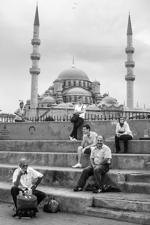 People waiting in Eminonu transport hub, in front of the New Mosque (Yeni Cami), in Istanbul.