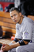 CINCINNATI, OH - AUGUST 9: Carlos Gonzalez #5 of the Colorado Rockies looks on against the Cincinnati Reds at Great American Ball Park on August 9, 2011 in Cincinnati, Ohio. The Rockies defeated the Reds 3-2. (Photo by Joe Robbins) *** Local Caption *** Carlos Gonzalez