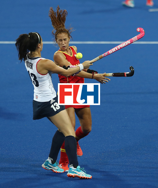RIO DE JANEIRO, BRAZIL - AUGUST 15:  Sam Quek (L) of Great Britain challenges Begona Garcia during the Women's quarter final hockey match between Great Britain and Spain on Day10 of the Rio 2016 Olympic Games held at the Olympic Hockey Centre on August 15, 2016 in Rio de Janeiro, Brazil.  (Photo by David Rogers/Getty Images)