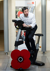 MSP's and staff from the Scottish Parliament hope to cycle the equivalent distance from Edinburgh to Glasgow to raise awareness for Poppy Scotland.<br /> <br />  Pictured: Scottish Parliament Presiding Officer Ken MacIntosh tests out the bike at the start of the challenge.<br /> <br /> © Dave Johnston/ EEm