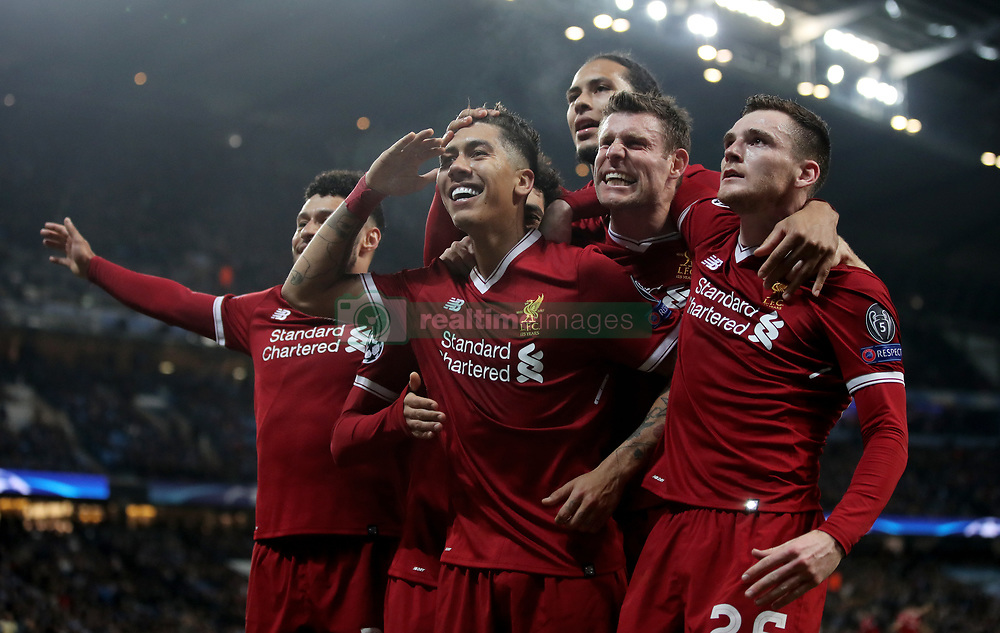 Liverpool's Roberto Firmino celebrates scoring his side's second goal of the game during the UEFA Champions League, Quarter Final at the Etihad Stadium, Manchester.