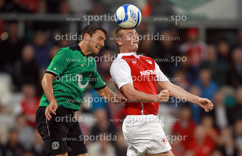 Europa League Third Qualifying Round 1st Leg, Dublin 2/8/2012.St. Patrick's Athletic vs Hannover 96.Kenny Browne of Pats with Mario Eggiman of Hannover. *** Local Caption *** © pixathlon
