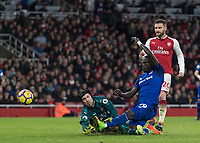 Football - 2017 / 2018 Premier League - Arsenal vs. Everton<br /> <br /> Oumar Niasse (Everton FC ) flies to to rea h the ball before Petr Cech (Arsenal FC) in a challenge that eventually resulted in the Arsenal goalkeeper being substituted at The Emirates.<br /> <br /> COLORSPORT/DANIEL BEARHAM
