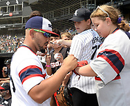 CHICAGO - AUGUST 12:  Jose Abreu #79 of the Chicago White Sox signs autographs prior to the game against the Cleveland Indians on August 12, 2018 at Guaranteed Rate Field in Chicago, Illinois.  (Photo by Ron Vesely)  Subject: Jose Abreu