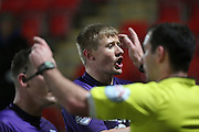 Referee waves away penalty protests during the Sky Bet League 2 match between Cheltenham Town and Morecambe at Whaddon Road, Cheltenham, England on 16 January 2015. Photo by Shane Healey.
