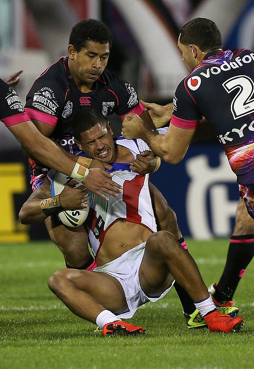 Sebastine Ikahihifo of the New Zealand Warriors tackles Dane Gagai of the Newcastle Knights during their round 12 NRL match at Mount Smart Stadium, Auckland on  Sunday, May 31, 2015. Credit: SNPA / David Rowland