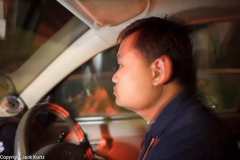 """02 OCTOBER 2009 -- BANGKOK, THAILAND:  YOTHAPONG TAWATCHAI, a volunteer with Poh Teck Tung races through Bangkok city streets to answer a medical call. The 1,000 plus volunteers of the Poh Teck Tung Foundation are really Bangkok's first responders. Famous because they pick up the dead bodies after murders, traffic accidents, suicides and other unplanned, often violent deaths, they really do much more. Their medics respond to medical emergencies, from minor bumps and scrapes to major trauma. Their technicians respond to building collapses and traffic accidents with heavy equipment and the """"Jaws of Life"""" and their divers respond to accidents in the rivers and khlongs of Bangkok. The organization was founded by Chinese immigrants in Bangkok in 1909. Their efforts include a hospital, college tuition for the poor and tsunami relief.   PHOTO BY JACK KURTZ"""