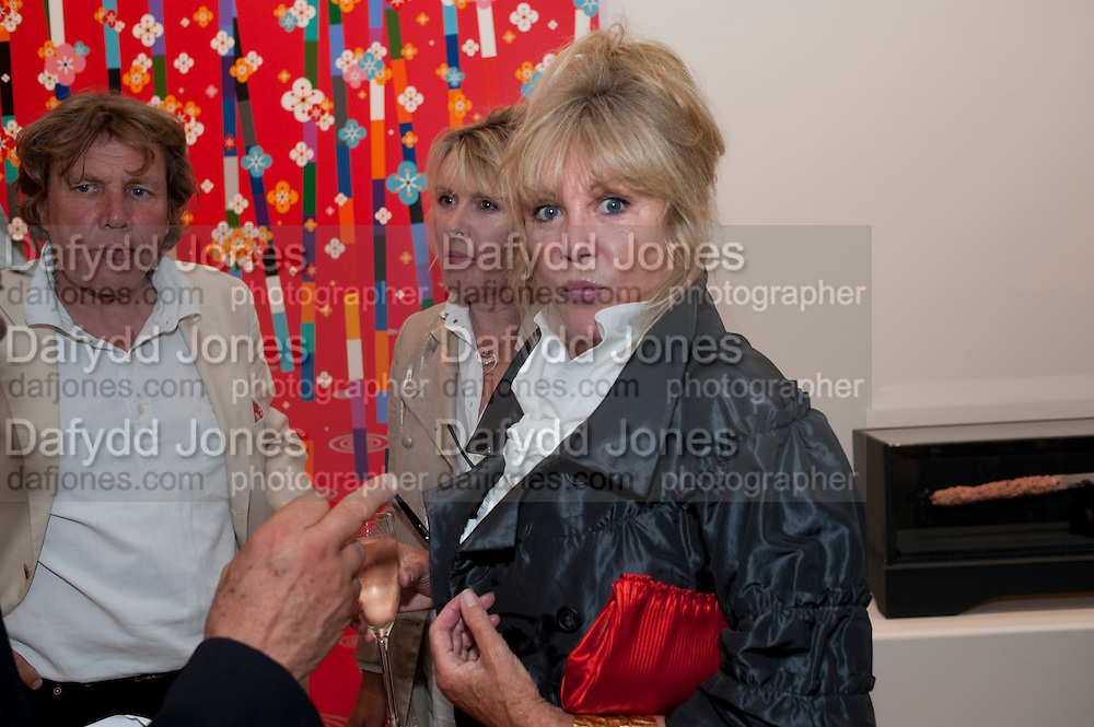 THEO FENNELL; LOUISE FENNELL; PATTI BOYD;  , Hear the World Ambassadors Ð An Exhibition of Photography by Bryan Adams , The Saatchi Gallery. Sloane sq. London. 21 July 2009. Hear the World - an initiative by Phonak, aims to raise international awareness about hearing and hearing loss<br /> THEO FENNELL; LOUISE FENNELL; PATTI BOYD;  , Hear the World Ambassadors ? An Exhibition of Photography by Bryan Adams , The Saatchi Gallery. Sloane sq. London. 21 July 2009. Hear the World - an initiative by Phonak, aims to raise international awareness about hearing and hearing loss