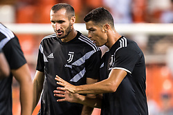 (L-R) Giorgio Chiellini of Juventus FC, Cristiano Ronaldo dos Santos Aveiro of Juventus FC during the UEFA Champions League group H match between Valencia FC and Juventus FC at Estadi de Mestalla on September 19, 2018 in Valencia, Spain