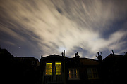 A south London home and the clouds above are illuminated by urban light pollution.