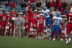 12 November 2005: Redbird Tom Nelson can't quite hold on to this Drone pass.  It bounces off his helmet. Illinois State Redbirds topple the Indiana State Sycamore 70-28 at Hancock Stadium in Normal Illinois
