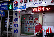 A cardboard image of an airline attendant in seen in the window of a China Eastern travel agency in Shanghai.