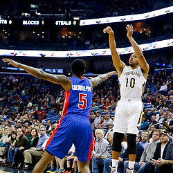 Dec 11, 2013; New Orleans, LA, USA; New Orleans Pelicans shooting guard Eric Gordon (10) shoots over Detroit Pistons shooting guard Kentavious Caldwell-Pope (5) during the first quarter at New Orleans Arena. Mandatory Credit: Derick E. Hingle-USA TODAY Sports
