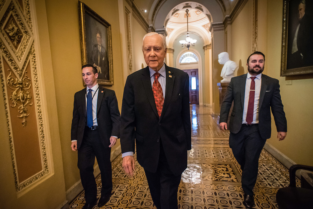 WASHINGTON, DC -- 12/21/17 -- Flanked by his security staff on the left and Matt Whitlock, his communications director on the right, Sen. Hatch makes his way to a luncheon. Senator Orrin Hatch is the senior senator from Utah, Chairman of the Senate Finance Committee and President pro tempore of the United States Senate..…by André Chung #_AC18079