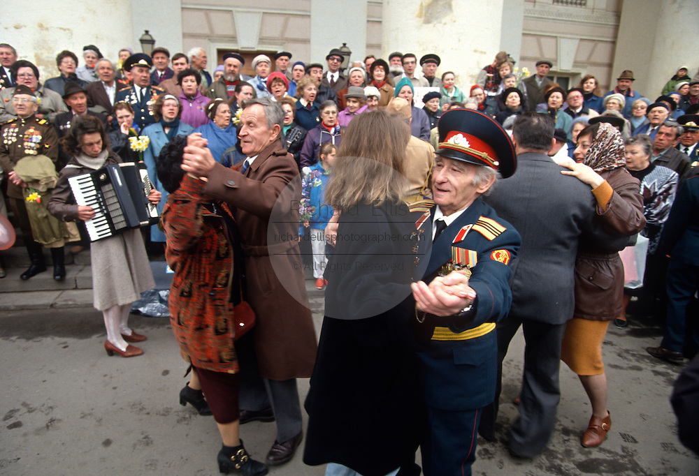 Russian World War II veterans dance during as they celebrate Victory Day in the Bolshoi Gardens in Moscow, Russia.
