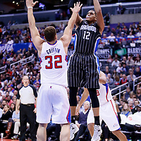 06 January 2014: Orlando Magic small forward Tobias Harris (12) takes a jumpshot over Los Angeles Clippers power forward Blake Griffin (32) during the Los Angeles Clippers 101-81 victory over the Orlando Magic at the Staples Center, Los Angeles, California, USA.