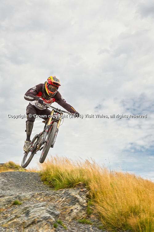 Biker at top of downhill trail<br /> Antur Stiniog<br /> Blaenau Ffestiniog<br /> Gwynedd<br /> North<br /> Mountain Biking<br /> Activities and Sports