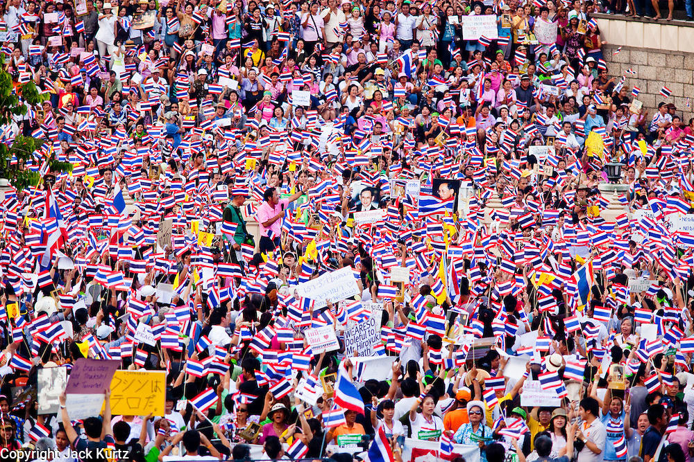 """Apr. 18, 2010 - Bangkok, Thailand: Thousands of so called """"Pink Shirts"""" jammed the area around Victory Monument in Bangkok to show support the Thai Monarch, King Bhumibol Adulyadej, and against the Red Shirts, who are demonstrating just a few kilometres away in the Ratchaprasong area. The Pink Shirts claim to not support either of the other political factions who wear colors - the Red Shirts, who support deposed Prime Minister Thaksin Shinawatra and their opponents the Yellow Shirts, who are against Thaksin.   Photo By Jack Kurtz"""