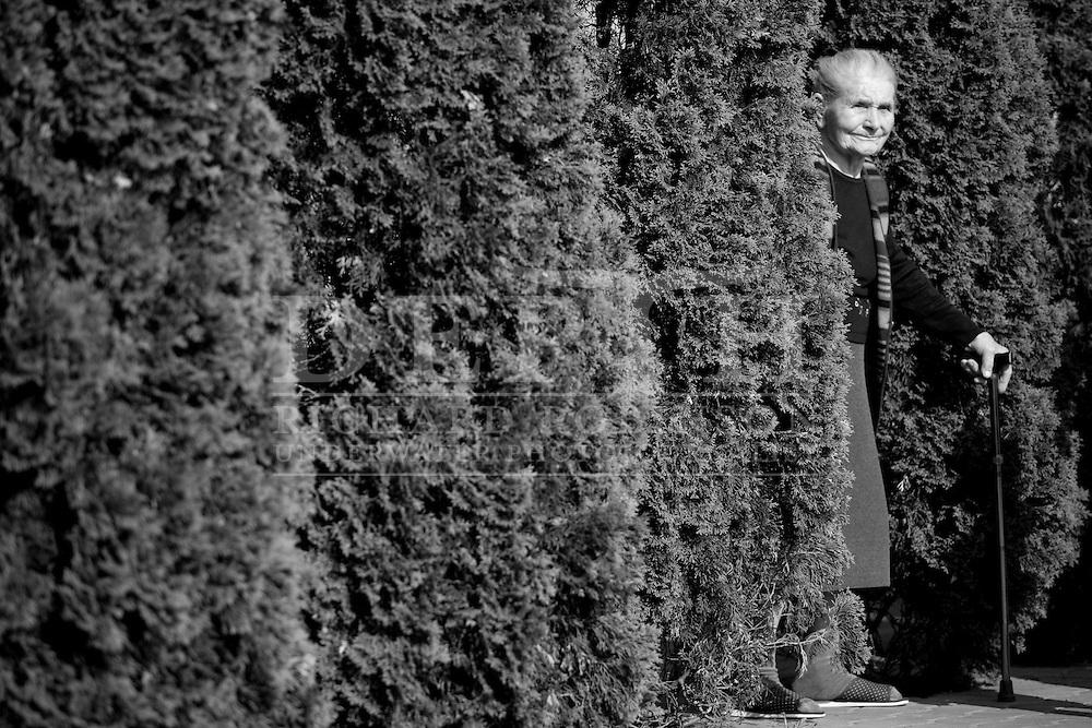 Maria Stolarska watches her granddaughter leave for her wedding.Polish wedding of Izabela Stolarska and Piotr Koziol in the suburb of Marki in Warszawa Poland..Saturday 08 May 2010.Photograph Richard Robinson © 2010.