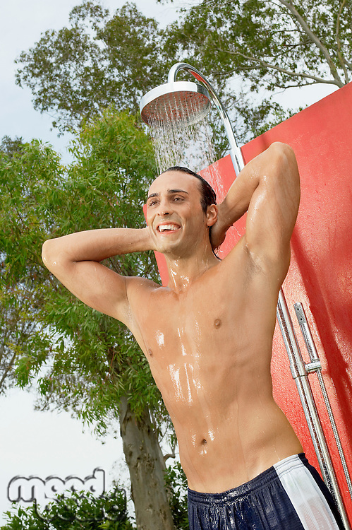 Man Using Outdoor Shower