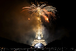 © Licensed to London News Pictures. 14/07/2015. Paris, FRANCE.  A firework display on The Eiffel Tower in Paris  to celebrate Bastille Day on 14, July 2015. Photo credit: Jason Bryant/LNP
