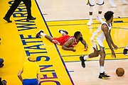 Houston Rockets guard James Harden (13) lays on the ground after missing a lay up against the Golden State Warriors during Game 6 of the Western Conference Finals at Oracle Arena in Oakland, Calif., on May 26, 2018. (Stan Olszewski/Special to S.F. Examiner)