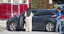 THEMENBILD, eine Arabische Frau in einer Burka gekleidet, steigt in ein Auto als Fahrerin ein. Jedes Jahr besuchen mehrere Tausend Gäste aus dem arabischen Raum die Urlaubsregion im Salzburger Pinzgau, aufgenommen am 07.08.2014 in Kaprun, Österreich // an Arab woman dressed in a burqa, gets into a car as a driver. Every year thousands of guests from Arab countries takes their holiday in Zell am See - Kaprun Region, Kaprun, Austria on 2014/08/07. EXPA Pictures © 2014, PhotoCredit: EXPA/ JFK