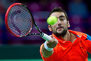 Marin Cilic of Croatia competes at men's single game during the BNP Paribas Davis Cup 2014 between Poland and Croatia at Torwar Hall in Warsaw on April 6, 2014.<br /> <br /> Poland, Warsaw, April 6, 2014<br /> <br /> Picture also available in RAW (NEF) or TIFF format on special request.<br /> <br /> For editorial use only. Any commercial or promotional use requires permission.<br /> <br /> Mandatory credit:<br /> Photo by © Adam Nurkiewicz / Mediasport