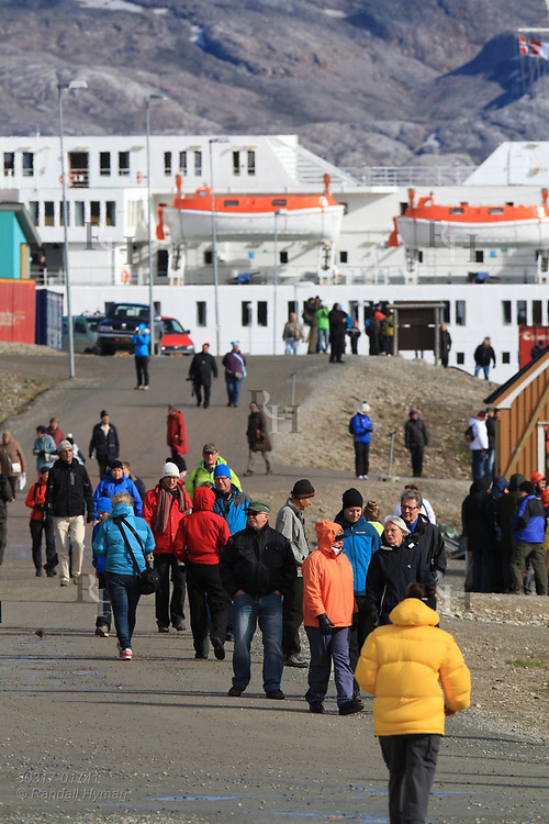 Cruise ship passengers fill road leading into the international science village of Ny-Alesund on Spitsbergen island in Kongsfjorden; Svalbard, Norway.