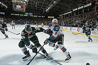KELOWNA, CANADA - JANUARY 23: Dillon Dube #19 of Kelowna Rockets is checked by Cole MacDonald #26 of Everett Silvertips on January 23, 2015 at Prospera Place in Kelowna, British Columbia, Canada.  (Photo by Marissa Baecker/Shoot the Breeze)  *** Local Caption *** Dillon Dube; Cole MacDonald;