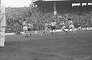 Kerry kicks the ball up field clearing it from his own goalmouth during the All Ireland Senior Gaelic Football Final, Kerry v Dublin in Croke Park on the 28th September 1975. Kerry 2-12 Dublin 0-11.