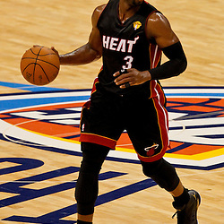 Jun 14, 2012; Oklahoma City, OK, USA; Miami Heat shooting guard Dwyane Wade (3) against the Oklahoma City Thunder during the first quarter of game two in the 2012 NBA Finals at Chesapeake Energy Arena. Mandatory Credit: Derick E. Hingle-US PRESSWIRE