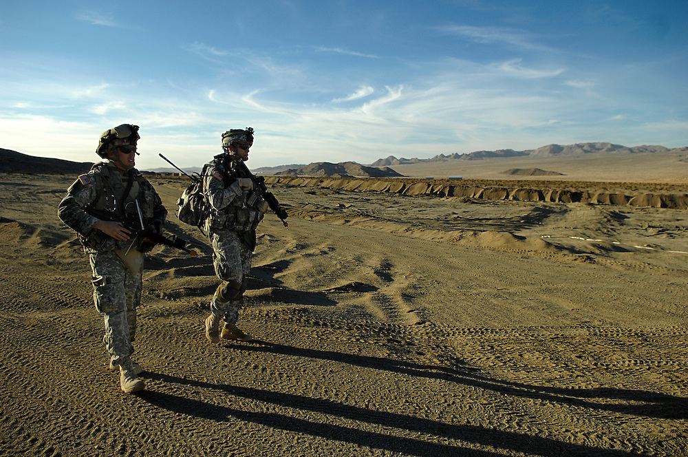 CPT David J. Smith and 2LT Mike Barth walk towards an observation point while Soldiers of Bravo Troop prepare for a combat patrol scenario, 3-1 Cavalry, 3rd HBCT, 3rd ID posts security during a combat patrol scenario at the National Training Center, Fort Irwin, CA on January 20, 2007. More than four thousand Soldiers from the Third Heavy Brigade Combat Team participate in a month long training rotation at The National Training Center to prepare them for future deployments.  (U.S. Air Force Photo by Staff Sgt. Weismiller)......................