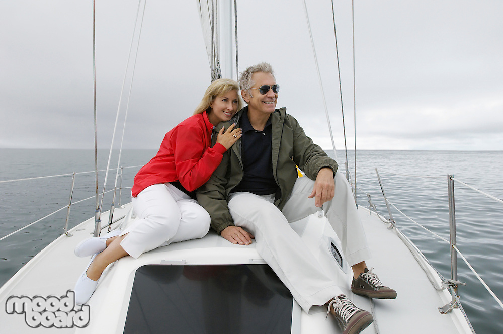 Couple relaxing on yacht