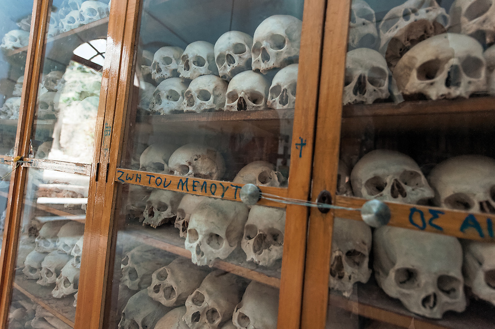 The ossuary of of the monastery Nea Moni in Chios. Many of the skulls have sword marks from the 1821 massacre of the island by the ottoman army. <br /> <br /> Nea Moni  is a monastery on the island of Chios, a  UNESCO World Heritage Site. It was built in the 11th century by Byzantine emperor Constantine IX Monomachos and his wife, Empress Zoe. The Katholikon (main church ) is dedicated to the Dormition of the Virgin Mary.
