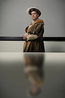 King Henry VIII standing at table in conference room portrait