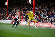 Rotherham United midfielder Aidan White looks to get past Brentford forward Sergi Canos in never ending first half battle during the Sky Bet Championship match between Brentford and Rotherham United at Griffin Park, London, England on 17 October 2015. Photo by Andy Walter.