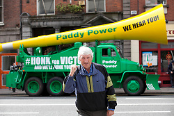 No fee for Repro: 17/06/2012 .Mick Dunne from Tallaght pictured as Top bookie Paddy Power sent its record breaking Vuvuzela truck onto the streets of Dublin on Sunday morning to help rally Ireland fans once last time around the Boys in Green ahead of their final Euro 2012 match against Italy tomorrow night.  Ireland fans can show their support by following the Twitter conversation #HONKforVICTORY! Picture: Andres Poveda Sharppix